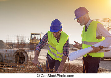 Worker and engineer at building site