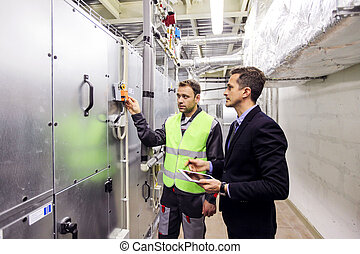 Worker and manager in switchgear room