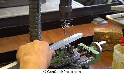 mechanism in metal workshop - worker and mechanism in metal...