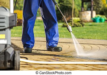 Worker and Pressure Washer