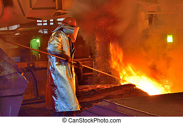 worker and production of cast iron inside of steel plant