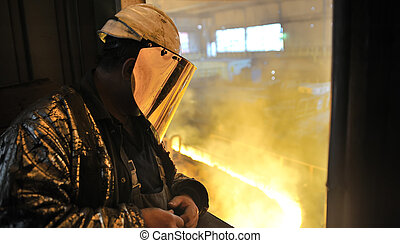 worker and  production of cast iron inside of plant