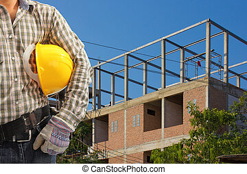 Worker and the construction background in blue sky