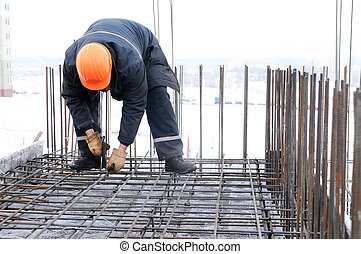 worker at construction site making carcass - worker in...