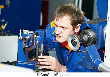 worker at machine tool operating