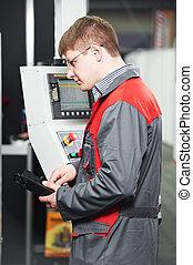 worker at machining tool workshop