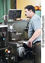 worker at machining tool workshop - mechanical technician...