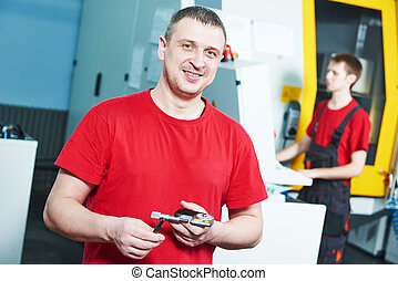 worker at tool workshop