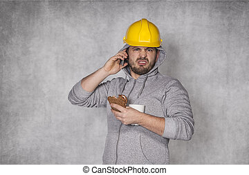 worker ate a sandwich and talking on the phone