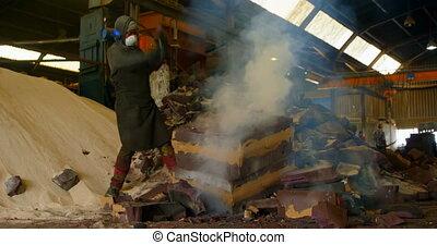 Worker breaking hot mold in foundry workshop 4k - Worker ...