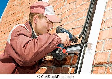worker builder with screwdriver - Builder laborer in work...