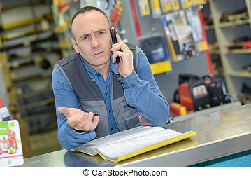 worker calling on the phone in a warehouse