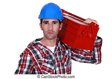 Worker carrying a toolbox