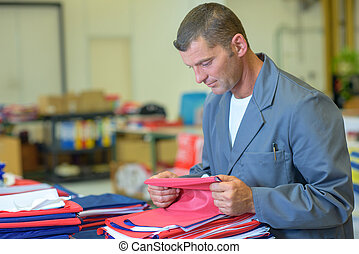 worker checking the fabric