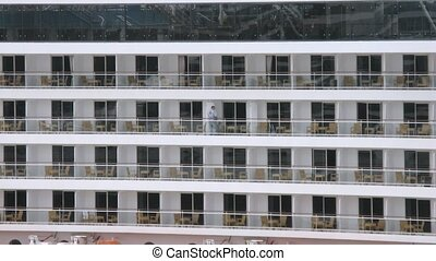 Worker clean balconies of cruise liner, time lapse - Worker...