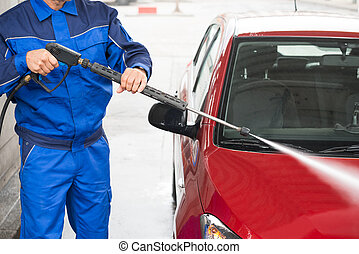 Worker Cleaning Car With Jet Sprayer At Service Station -...