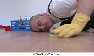 Worker cleaning laminate close up
