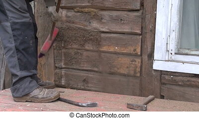 worker cleaning old wooden wall - worker with brush cleaning...
