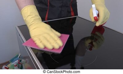 Worker cleaning surface of electric cooker