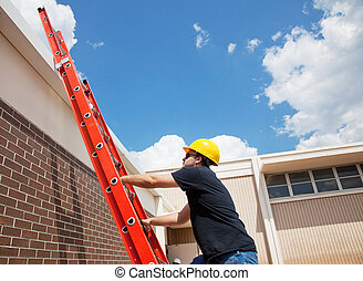 Worker Climbing Up - Construction worker climbing up to the...