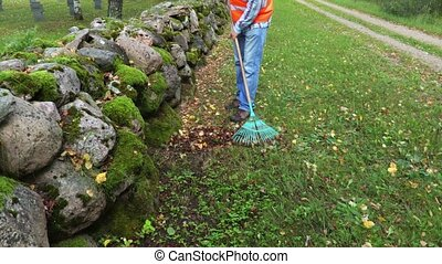 Worker collects leaves