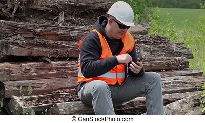 Worker comparing the terms of reference