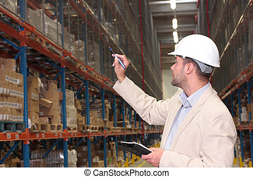 worker counting stocks - A worker counting the ready ...