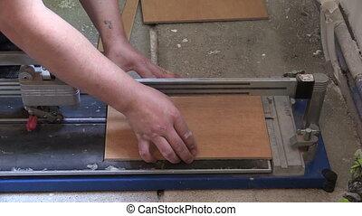 worker cut tiles - Worker tiler man use tile cut tool on...