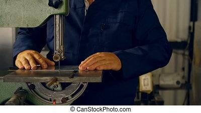 Worker cutting metal sheet in hangar 4k
