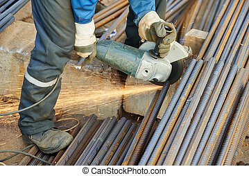 worker cutting rebar by grinding machine - Construction...