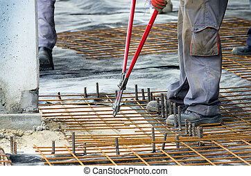 Worker cutting reinforcement mesh