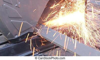 Worker Cutting Steel Metal With Grinder