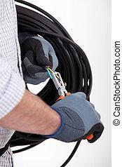 Worker cutting wires