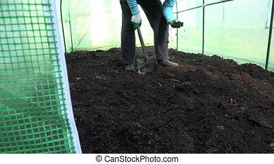 worker dig compost garden