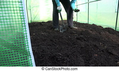 worker dig compost garden - man worker dig with shovel...