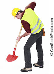 Worker digging with a shovel