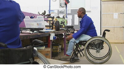 Worker disabled at work - Side view of two African American ...