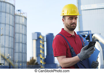 worker dressed in safety overalls outside a factory