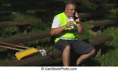 Worker drinking coffee and speaks by phone