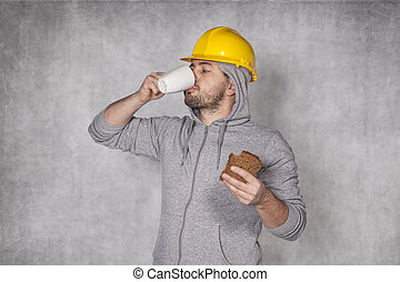 Worker drinking coffee during the break