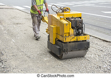 Vibration roller compactor - Worker driving Vibration roller...
