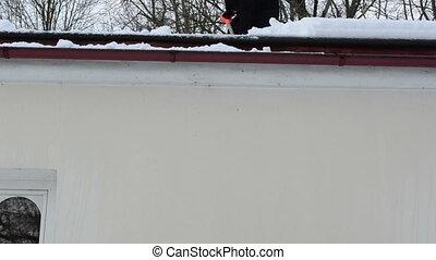 worker drop snow roof