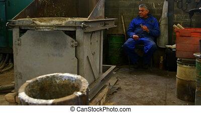 Worker eating food in foundry workshop 4k - Worker eating ...