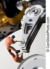 Worker figurine on hard drive
