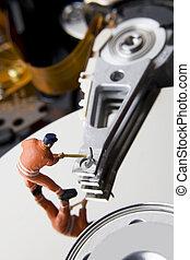 Worker figurine on hard drive