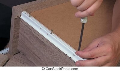 Worker finishing drawer