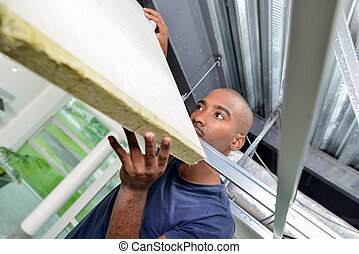 Worker fixing a ceiling