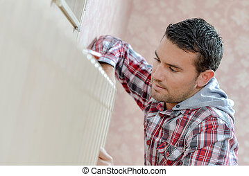 Worker fixing a radiator