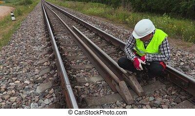 Worker fixing rails