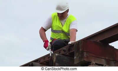 Worker fixing railway